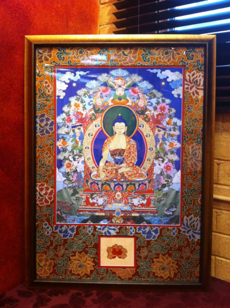 "Frame Dimensions: 39"" x 29"" (99x74 cm). Fine Art Print of Leslie Rinchen-Wongmo's original 1997 silk appliqué thangka of Buddha and the Six Supports."
